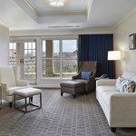 Presidential Suite - Living area with a spacious balcony overlooking King Street