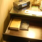 The Bible and the Book of Mormon in the nightstand (the coffee/tea service is tucked underneath)