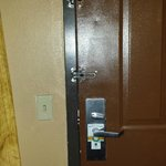 Front door with two double locks. The one that did not work was still on the door with no purpos