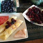 Breakfast: raspberry and blueberry crepes.