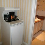 Coffee maker at entry alcove