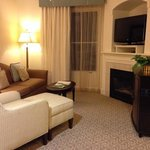 sitting area with tv and gas fireplace in king suite