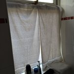 Towels covering the bathroom window for privacy