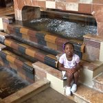 my daughter in lobby by fountain