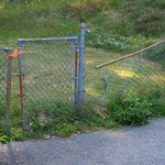 This fencing is located near the outdoor pool.