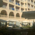Courtyard dining area and hotel exterior