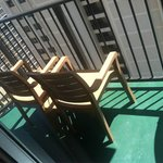 balcony, two chairs with small table