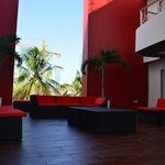 pool and balcony behind the red walls