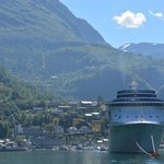 View from the Fjord of visiting cruise ship and our hotel