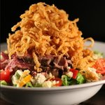 steak salad with onion straws