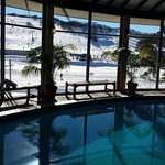 Indoor heated pool with view of the slopes