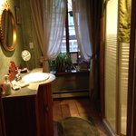 Bathroom. Shared between two bedrooms on second floor. Clean.  Watch the hot water ... The plate