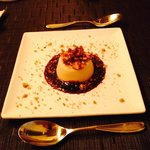 maple cheesecake with blueberry sauce and graham crumble