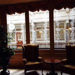 Sitting area next to the breakfast room. Plenty of windows overlooking the historic arcade.