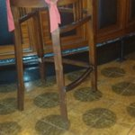 broken chairs in bar