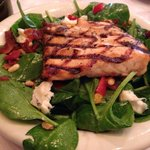 Spinach salad with salmon.