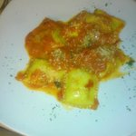 Ravioli with black olives and ricotta in tomato sauce