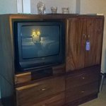 old tv and locked mini bar
