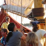 Assisting in hoisting the mainsail