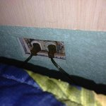 un-covered electrical outlet next to bed!!!
