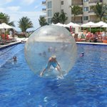 Fun activity for the kids getting in a mega ball in the pool