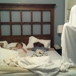 A ghost (dad) tries to wake up sleeping kids in Suite 223