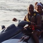 My husband and I jet skiing in Orange Beach