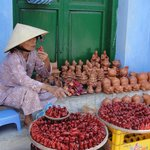 A vietnamese selling  whistles