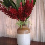 Flowers from the garden in an antique jar