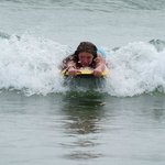 Kids love to surf the waves!
