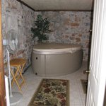 full jacuzzi with jets to set at different levels/ Wine Cellar Room