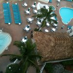 View of pool and tiki hut from 8th floor room