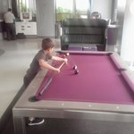 my son loving the pool table