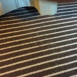 Dirty carpet (by bed)
