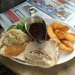 Roast pork barm with homemade chips, salad and delicious gravy.