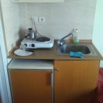 small kitchenette with fridge