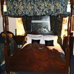 The comfy antique bed in the Four-Poster Room