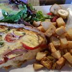 Quiche with home fries and greens
