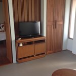 TV room with wooden bench