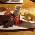 """The rump steak was """"okay"""", though overpriced at £17 and chips very dry/hard .. air-fried?"""