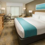 Relax on a plush mattress free Wi-Fi or watch an HBO movie on the 37-inch screen TV