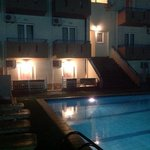 The pool and Sc ground floor rooms and balconies at night