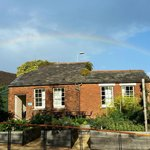 Potting shed (meeting room) from lawn with rainbow