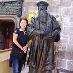 Visitor Standing besides John Knox Statue inside the St Giles Cathedral