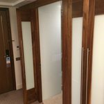 Entrance to bathroom, with wardrobe & hanging space either side. Very spacious and internally li