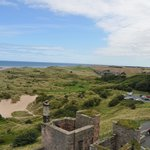 Looking from Bamburgh Castle to Seahouses .