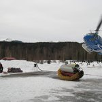 Chopper landing at the lodge