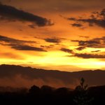 The sunset over Kibale National Park from my patio.