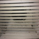 Vent directly over toilet, dirty
