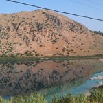The mountain opposite mirror-imaged in Lake Kournas.